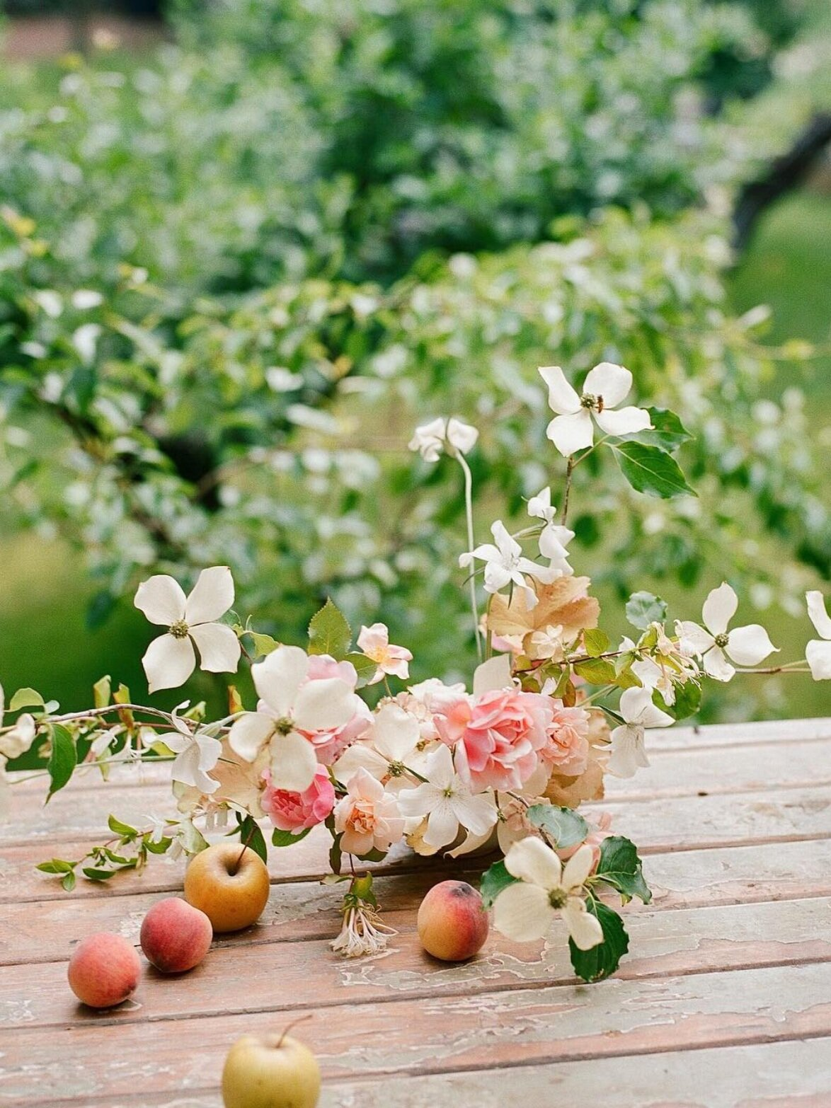 early summer wedding flowers. dogwood and rose floral arrangement