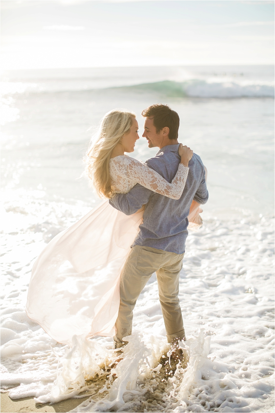 Here's a photo from a recent engagement session I did on the beach. Most of the time I end up knee deep in the ocean trying to get an awesome shot. When the waves washed up during this moment, I took the shot and then immediately lifted my camera above my head and pointed the lens towards the sky to avoid the lens getting splashed.