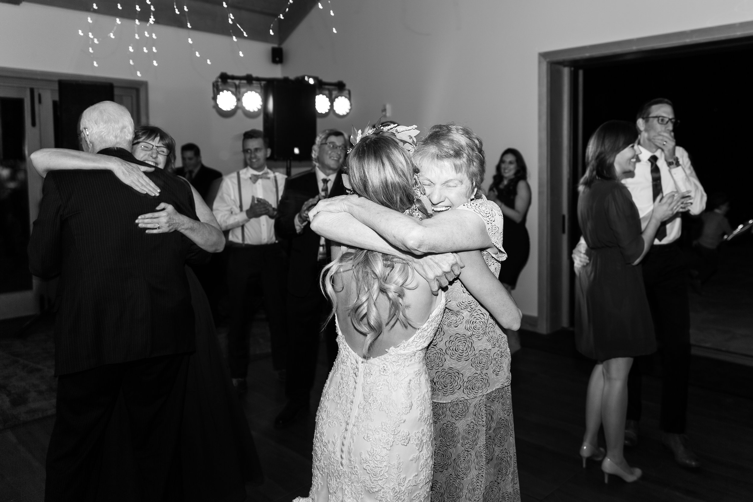 I absolutely adore this image of Julie and her grandmother on the dance floor. Her grandma's expression is one of infinite joy and it makes me happy when I look at it. Keep an eye out for important family members (like grandparents) and any interactions they may have with the couple. Don't watch them too closely though...that's creepy.