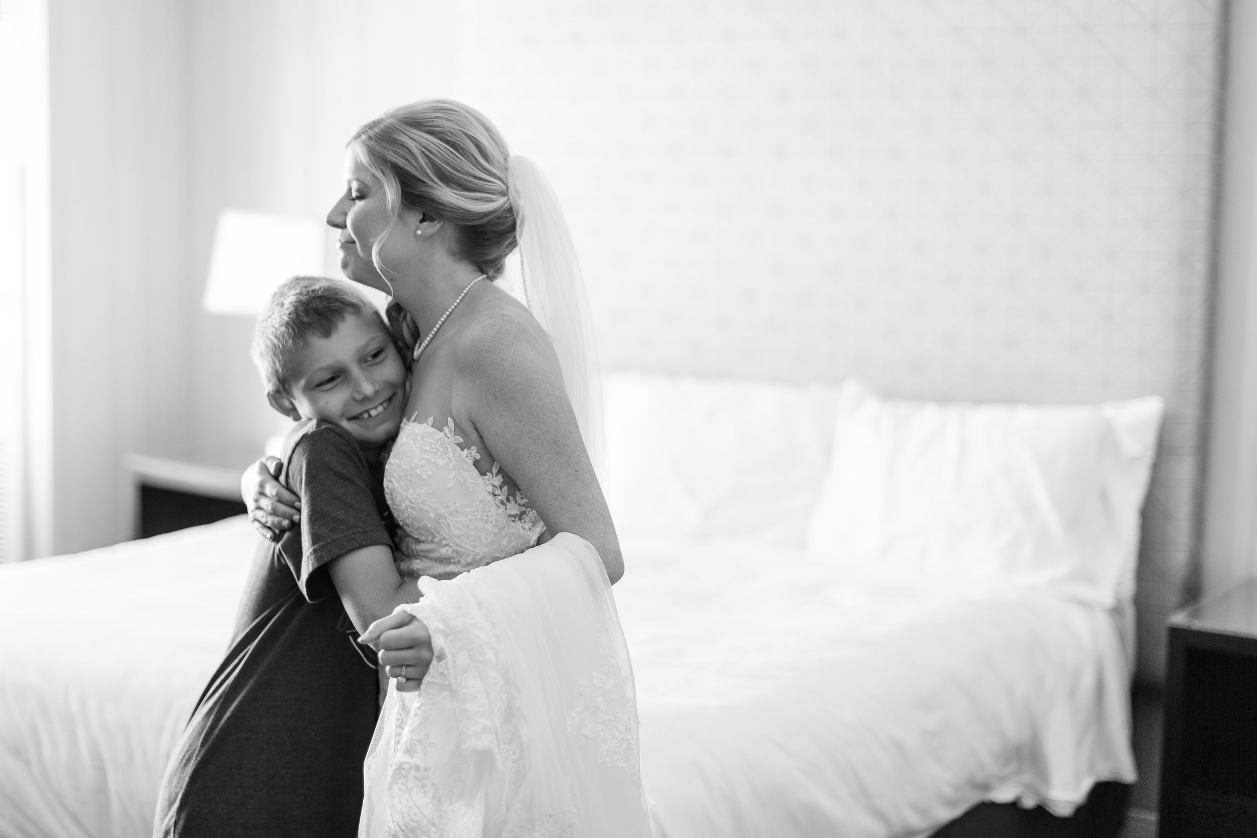 """This is a shot of the bride with her nephew after he saw her for the first time in awe and proclaimed, """"You look SO beautiful!"""""""