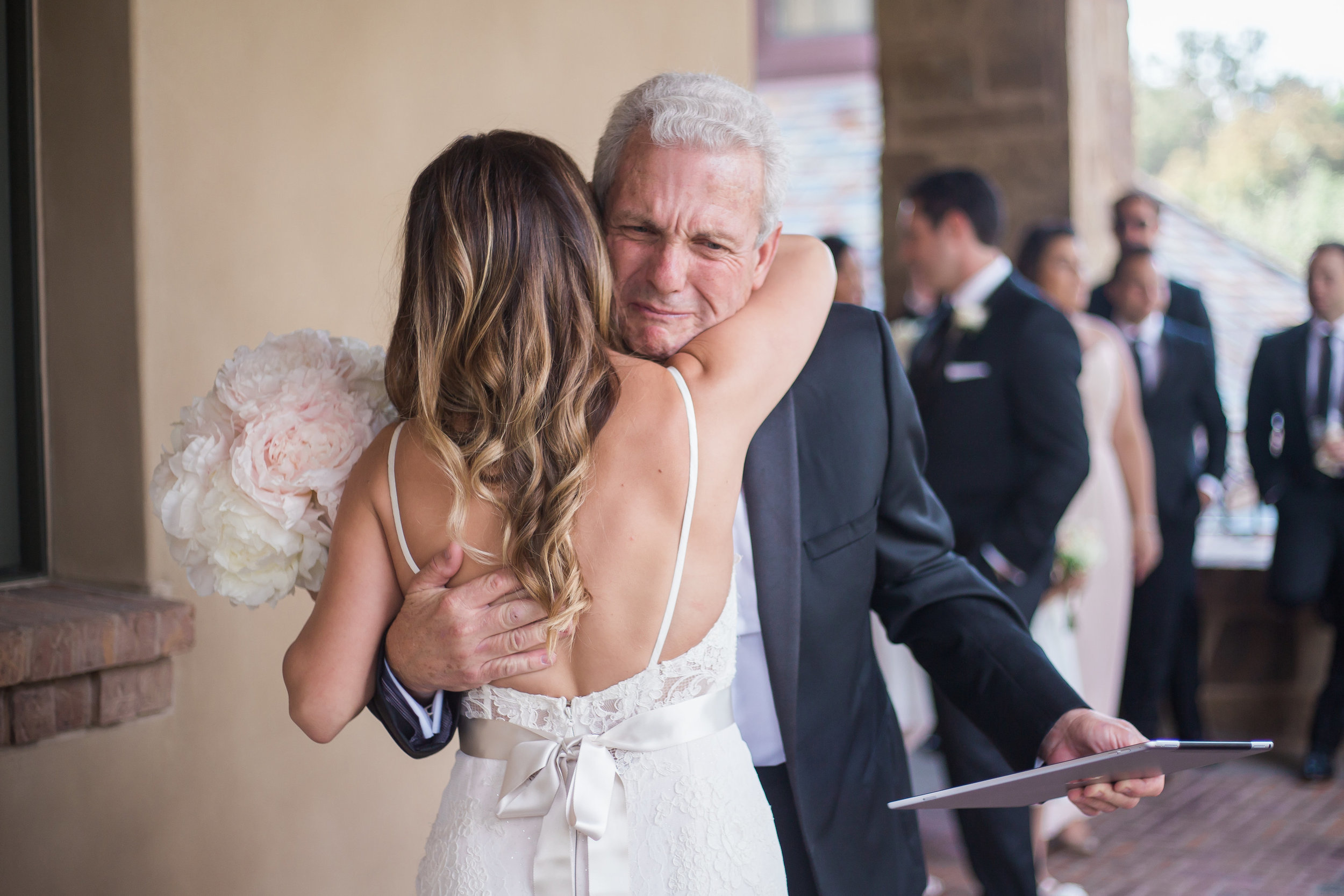 This shot is when the bride's new father-in-law walked around the corner to see her for the first time in her dress. It was so sweet how excited he was to have a new daughter in the family. You can tell how much he loves the woman his son has chosen.