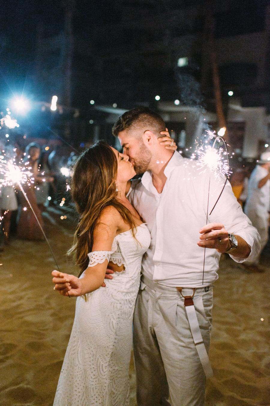 Mexico wedding sparkler exit kissing