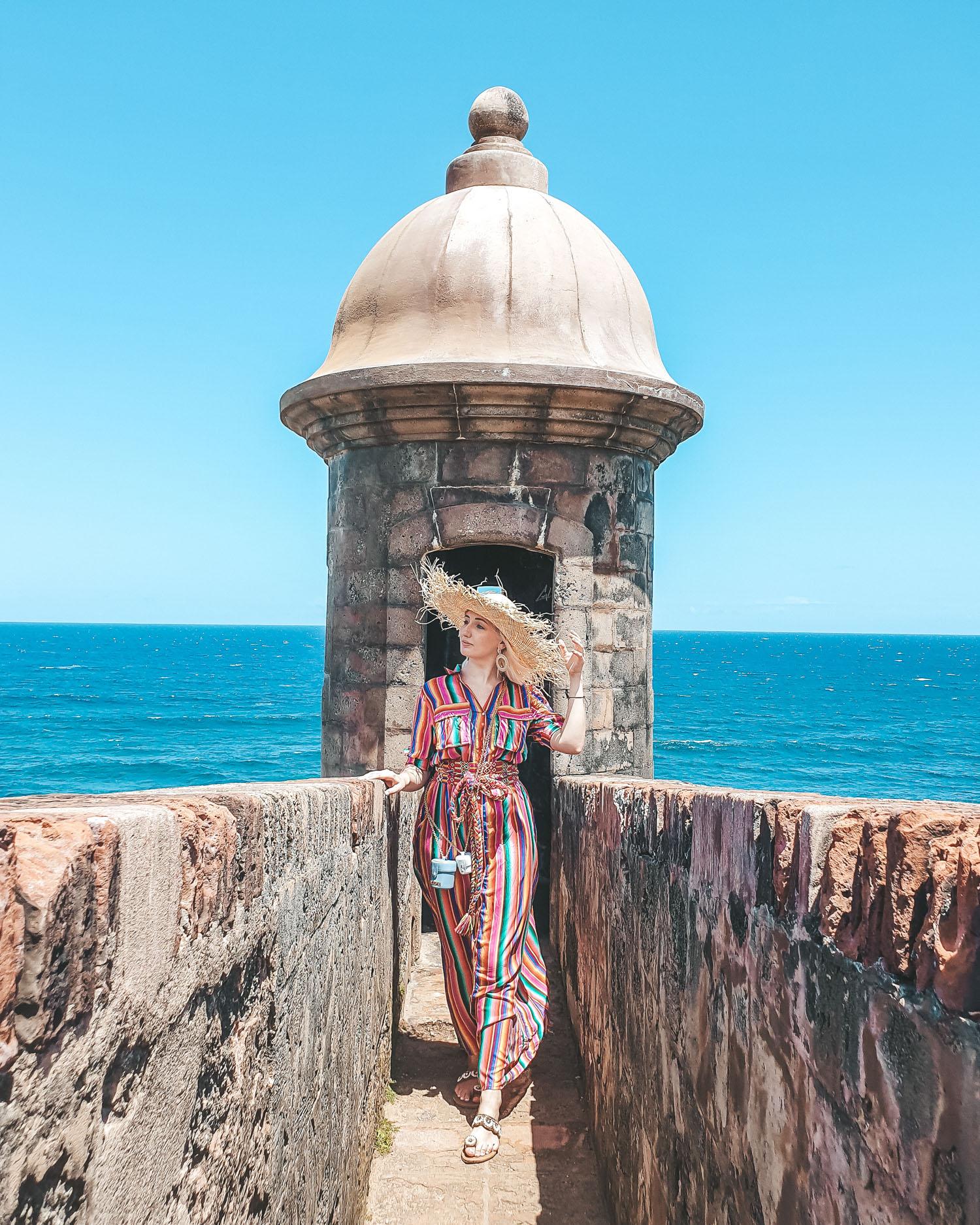 Travel Blogger wearing All Things Mochi rainbow dress