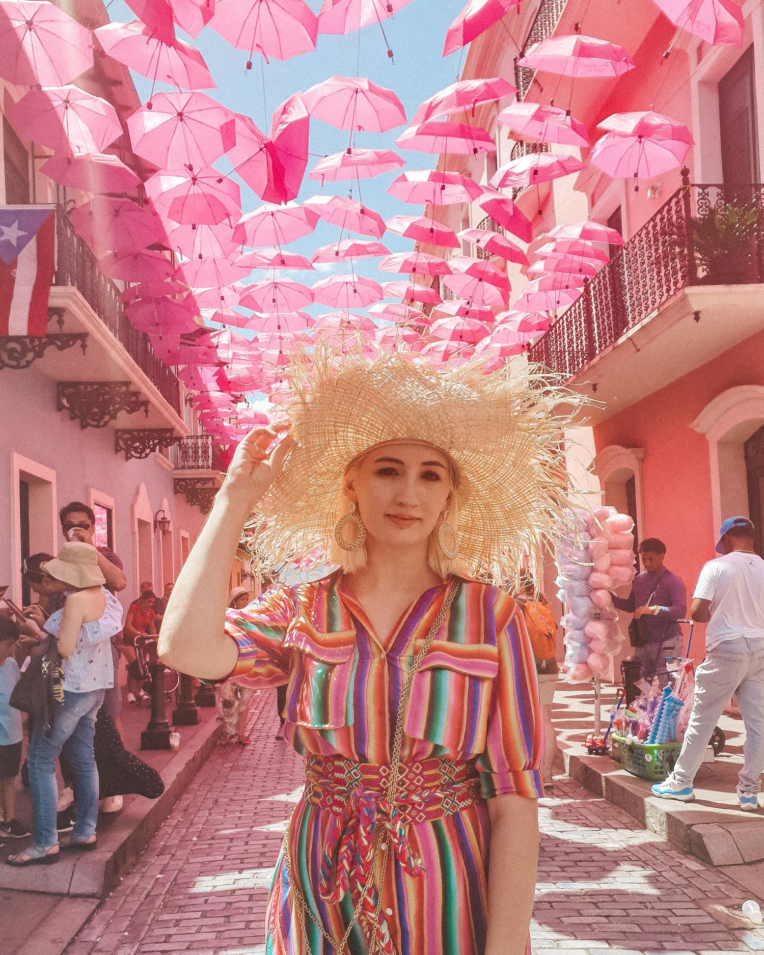Travel Blogger wearing All Things Mochi rainbow dress under umbrella street San Juan, Puerto Rico