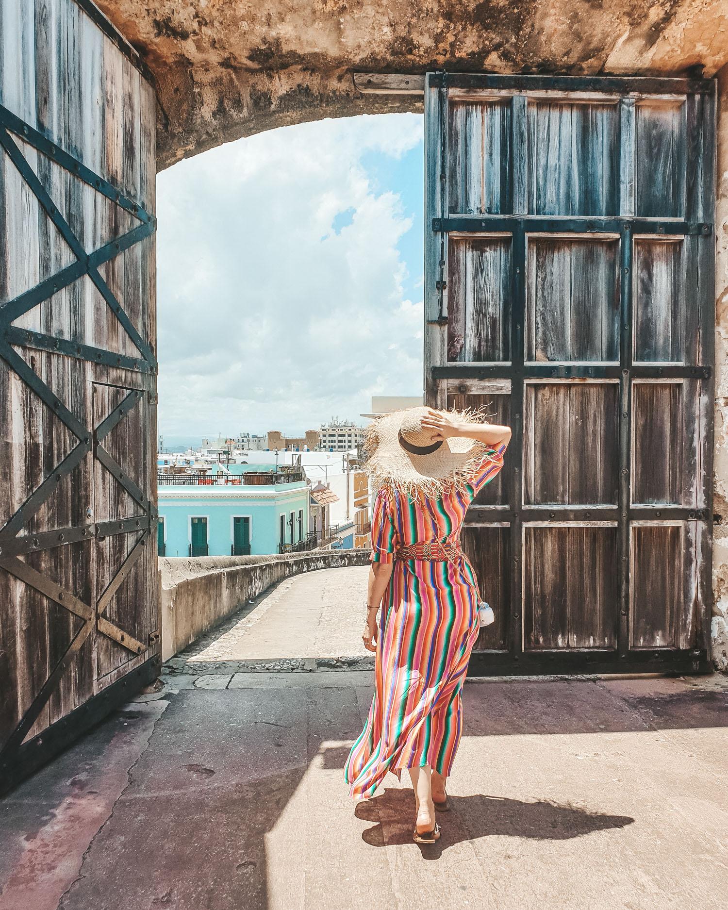 travel blogger wearing All Things Mochi rainbow dress in San Juan, Puerto Rico