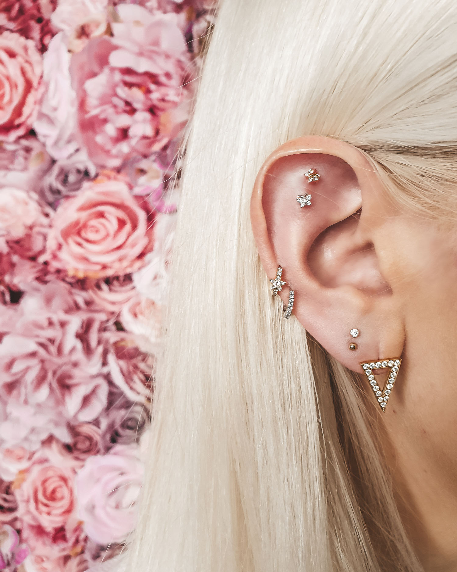 New piercings: double lobe piercings (the two next to the triangle earring)