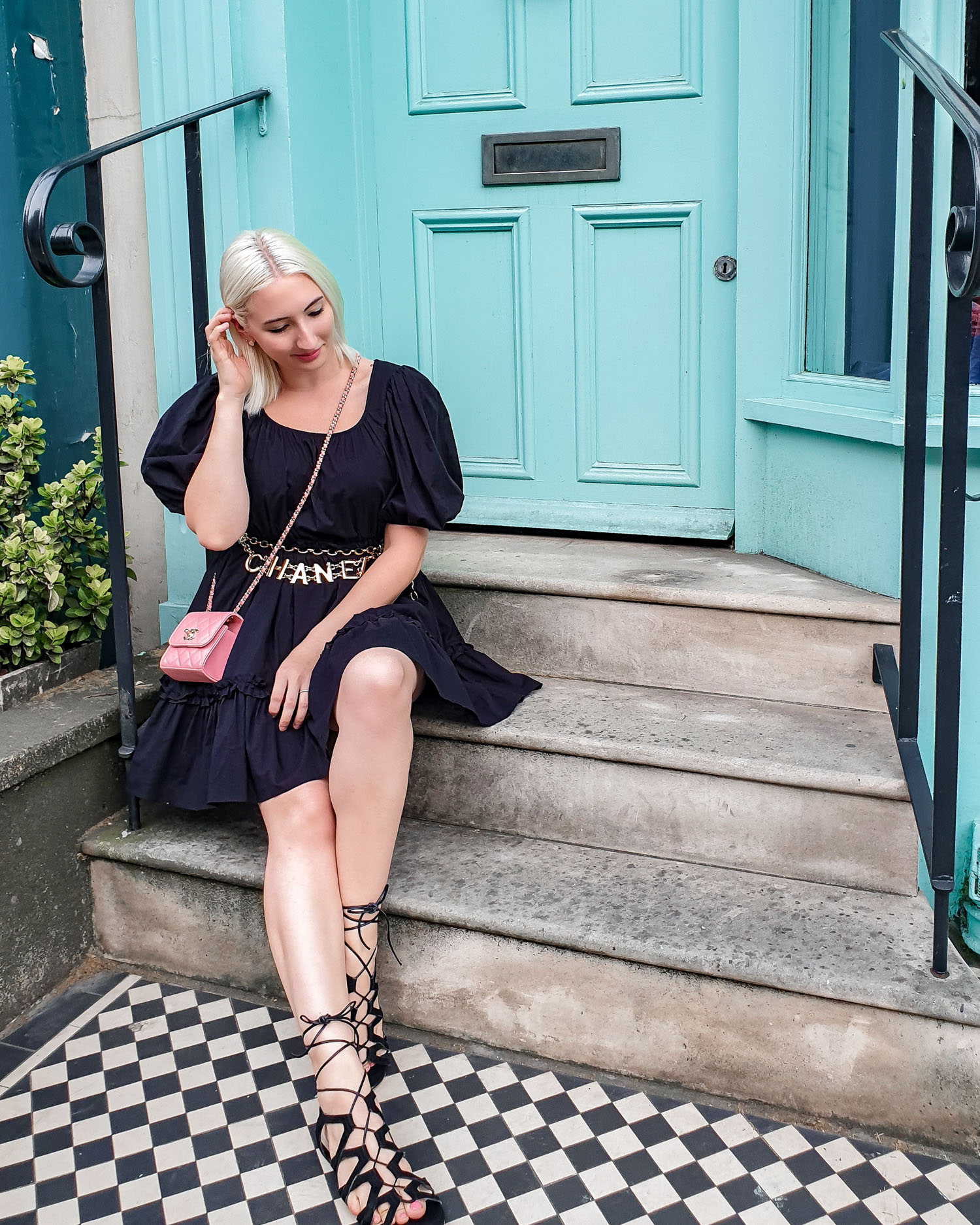 & Other Stories puff sleeve dress outfit | sitting on a stoop in London | pink Chanel bag and gladiator sandals