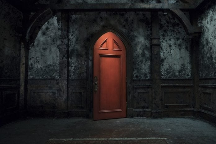 One can only assume this bright door in the decaying mansion is opening itself in Netflix's  The Haunting of Hill House .