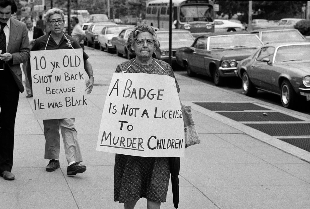 """""""Protesters in Queens in 1974 urged that a white police officer be convicted of murdering Clifford Glover, a black 10-year-old."""" Source: Don Hogan Charles/ The New York Times"""