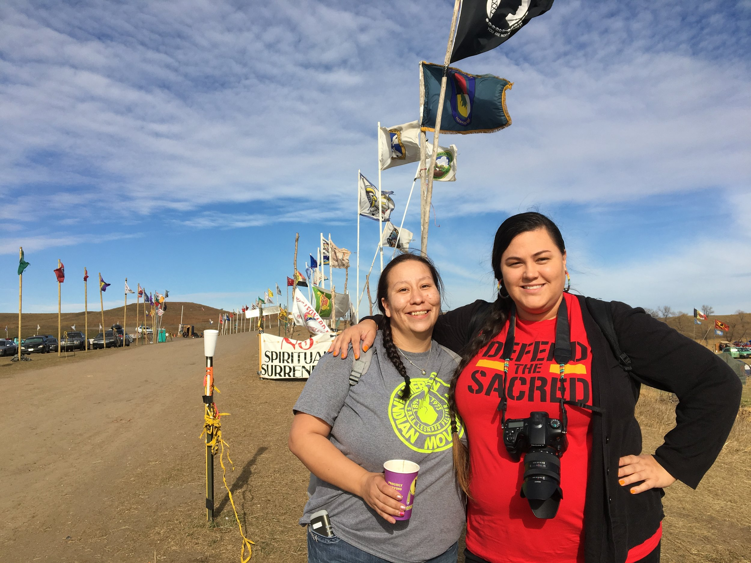 Taté Walker (right) is a writer, speaker, Indigenous rights activist, and editor of Natives Magazine.