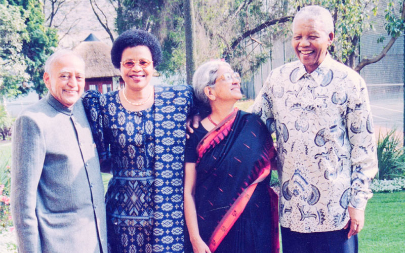 From left to right: Devaki Jain's husband L.C. Jain, Graca Mandela, Devaki Jain, Nelson Mandela. Johannesburg, 1999. Photo found on  devakijain.com .