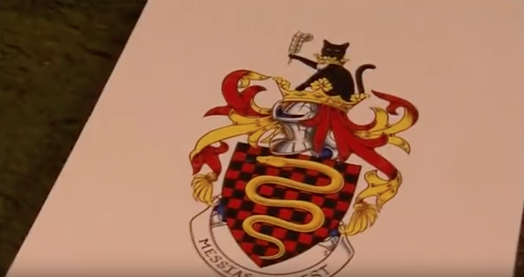 """Terry Jones' custom coat of arms includes a golden python (naturally), his cat holding a feather pen (to symbolize his writing career), and a  Life of Brian  reference in the latin phrase """"Messias non est."""" From  Terry Jones' Medieval Lives: The Knights."""