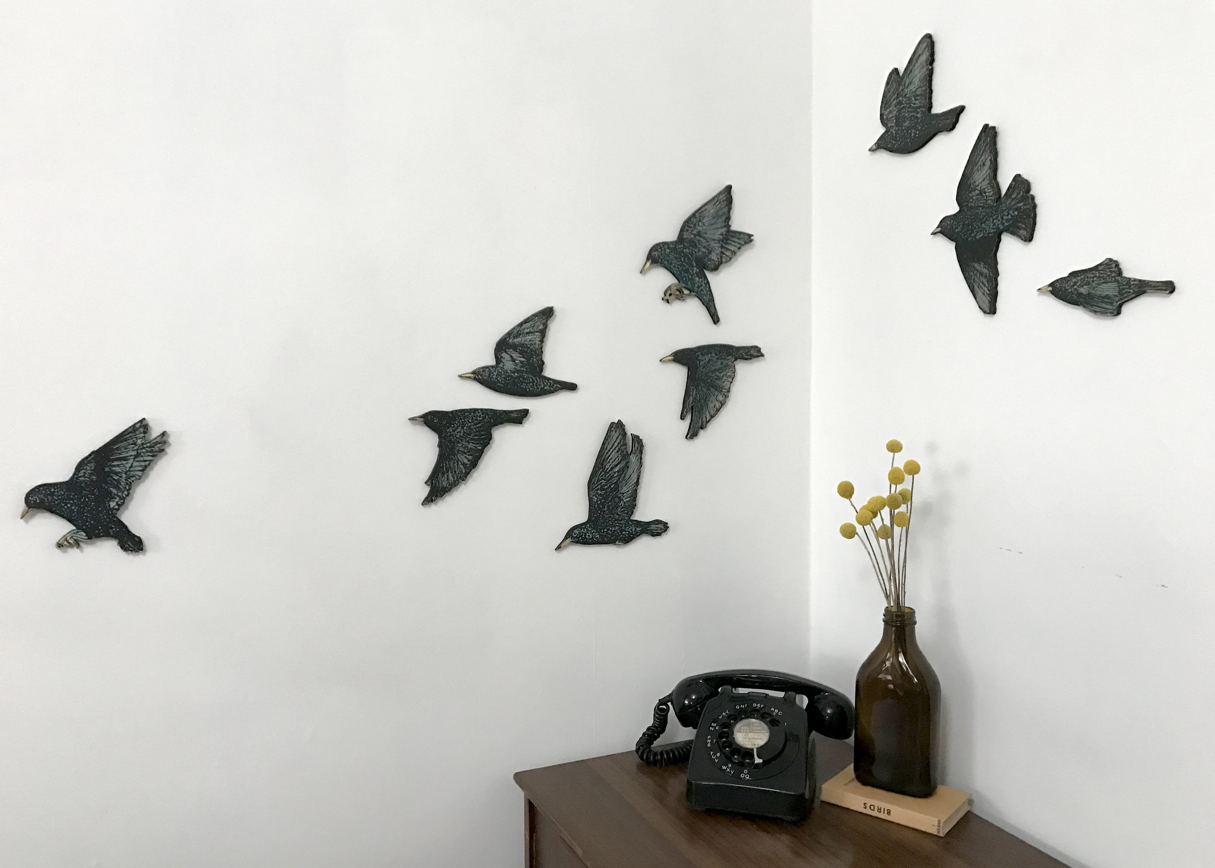 Murmuration of starling. 2017 Screen printed wooden installation. Edition of 12 sets of 9 birds. SOLD OUT