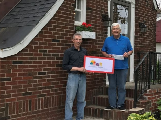 The First Fulton Block Builders Award Check Is Presented