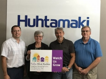 Mark Southwick, Huhtamaki Plant Manager and Joe McConnell Operations Manager are seen here with Linda Eagan, Fulton Block Builders (FBB) Administrative Director. Along with them is John Munk Huhtamaki Graphics Coordinator. John is also an FBB volunteer.