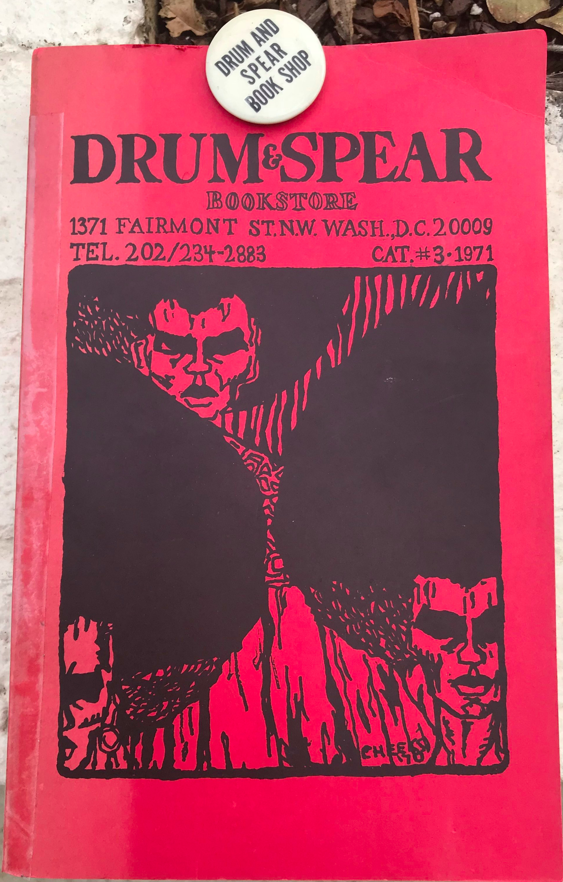 Courtesy Judy Richardson Collection.  Drum & Spear Book Store Catalog #3 , 1971 and Drum & Spear Book Shop pin-back button. Marya McQuirter, photographer. 8 November 2018. Drum & Spear moved to a larger space, around the corner from the original store, to 1371 Fairmont St NW by 1970.