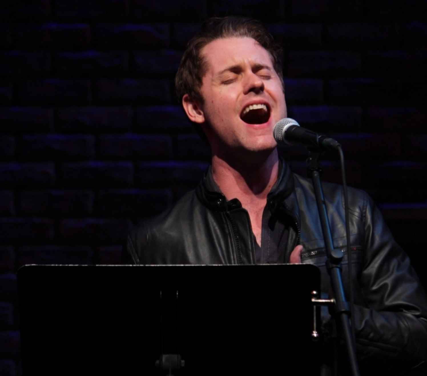 """Michael singing """"What's Lost"""" from  Outlaws in concert at New World Stages."""