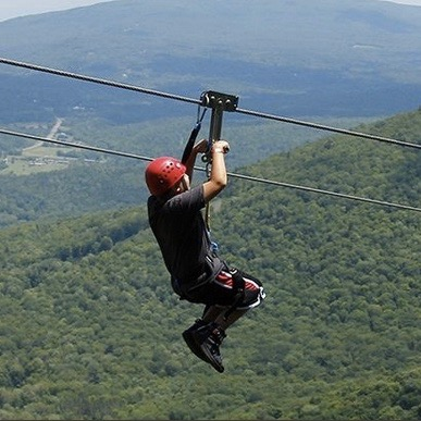 ZIPLINING  Zipline adventure parks at Hunter and Windham Mountains.