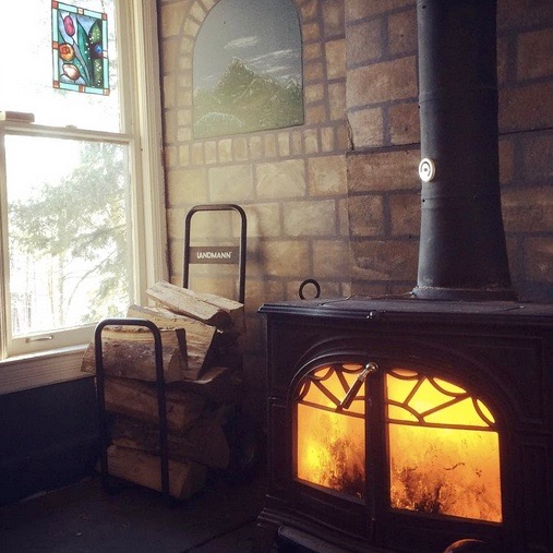 Warm up and kick back around our crackling wood stove.