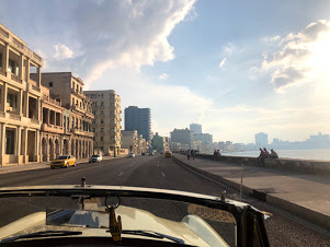 Beautiful sunset drive along the ocean in a 1950s American car (sorry can't remember which this one was :) ) in Havana