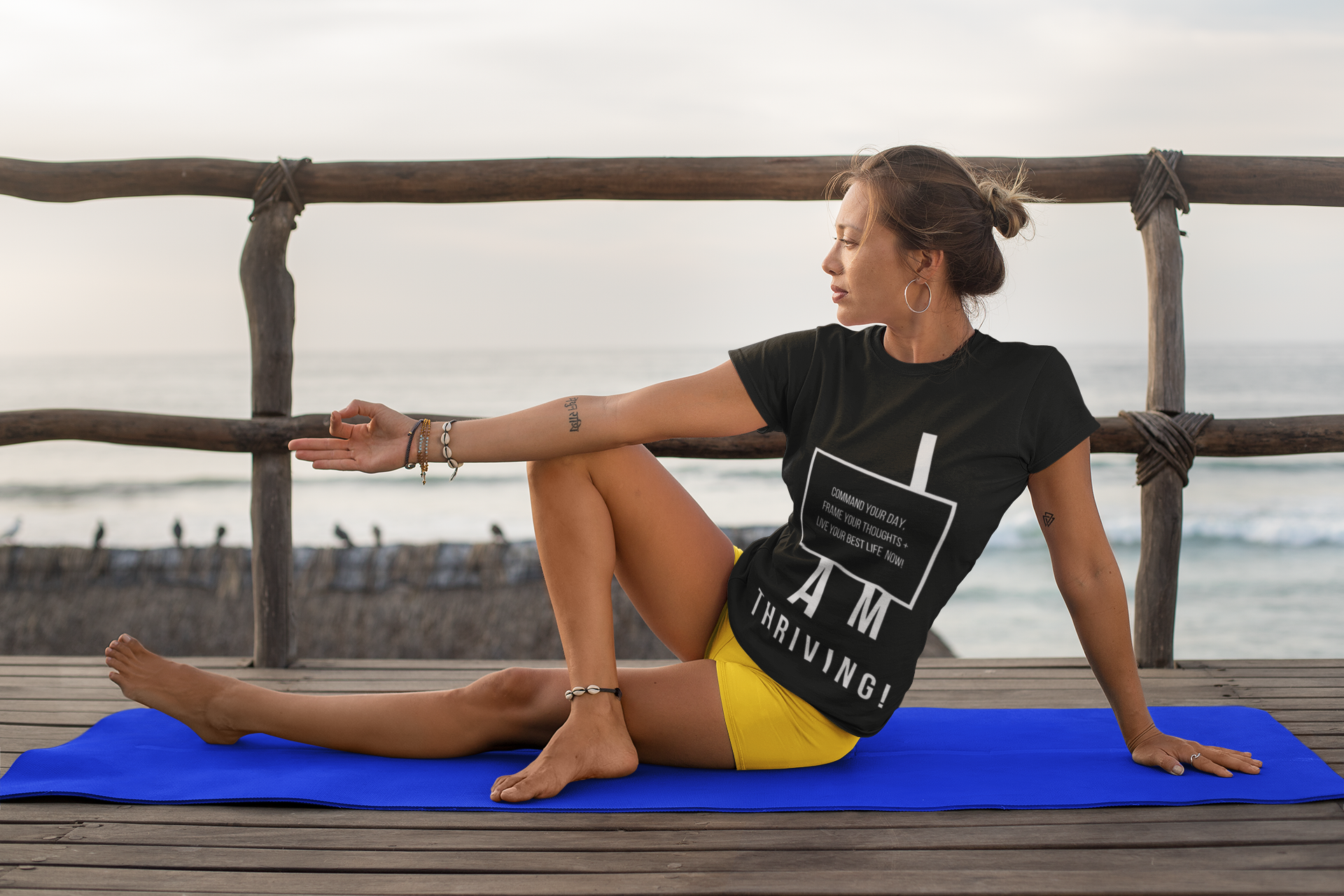 t-shirt-mockup-of-a-woman-doing-yoga-by-the-sea-26854.png