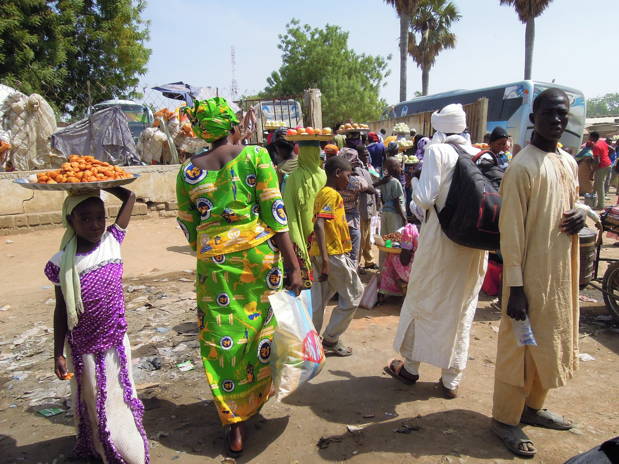 Locals sell food and other goods at a busy bus stop in Bongol, Chad, a small city on the drive from N'Djamena (Chad's capital city) to Kelo.