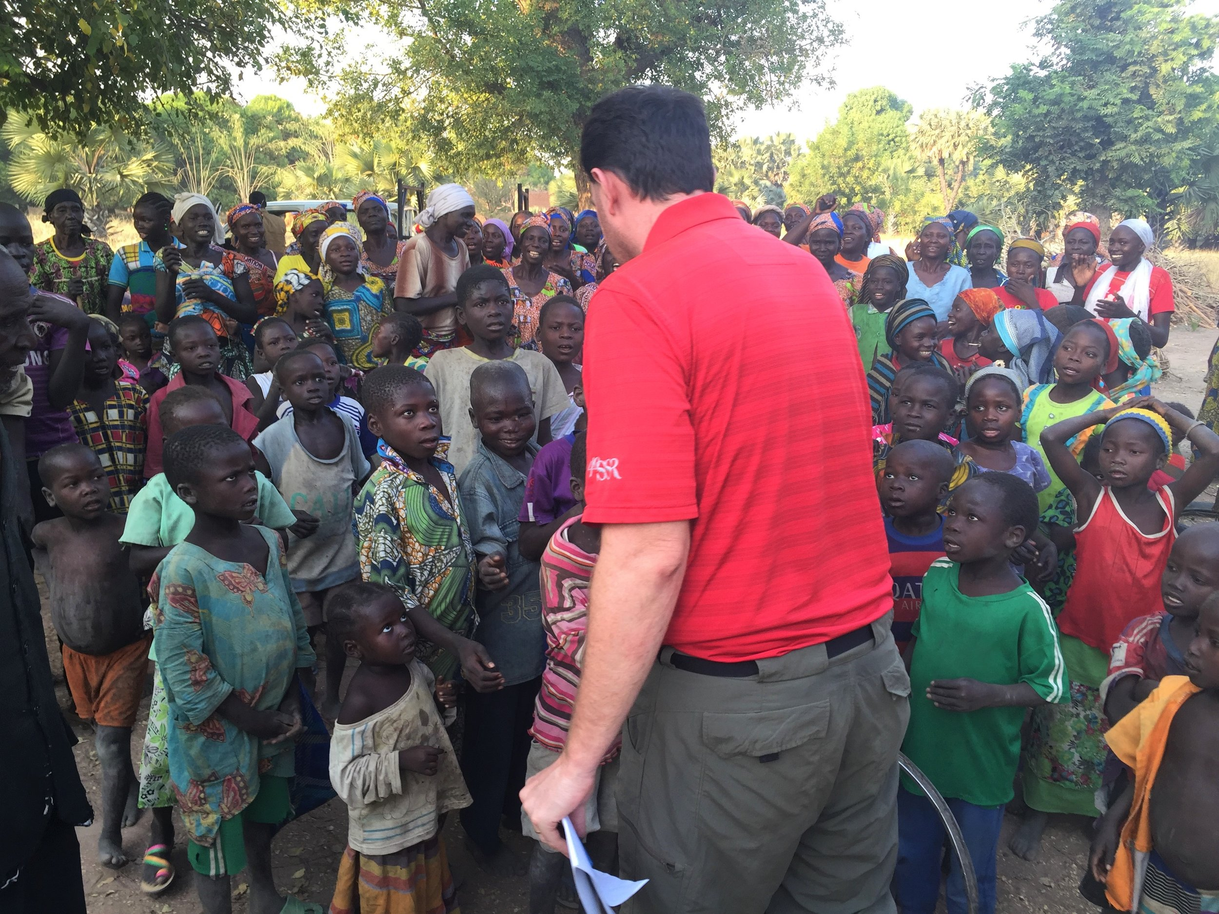 Living Water Project board member and water engineer Kevin Colvett is greeted by children in Meguene Degleo village in Chad. A new well was drilled there in December, 2016.
