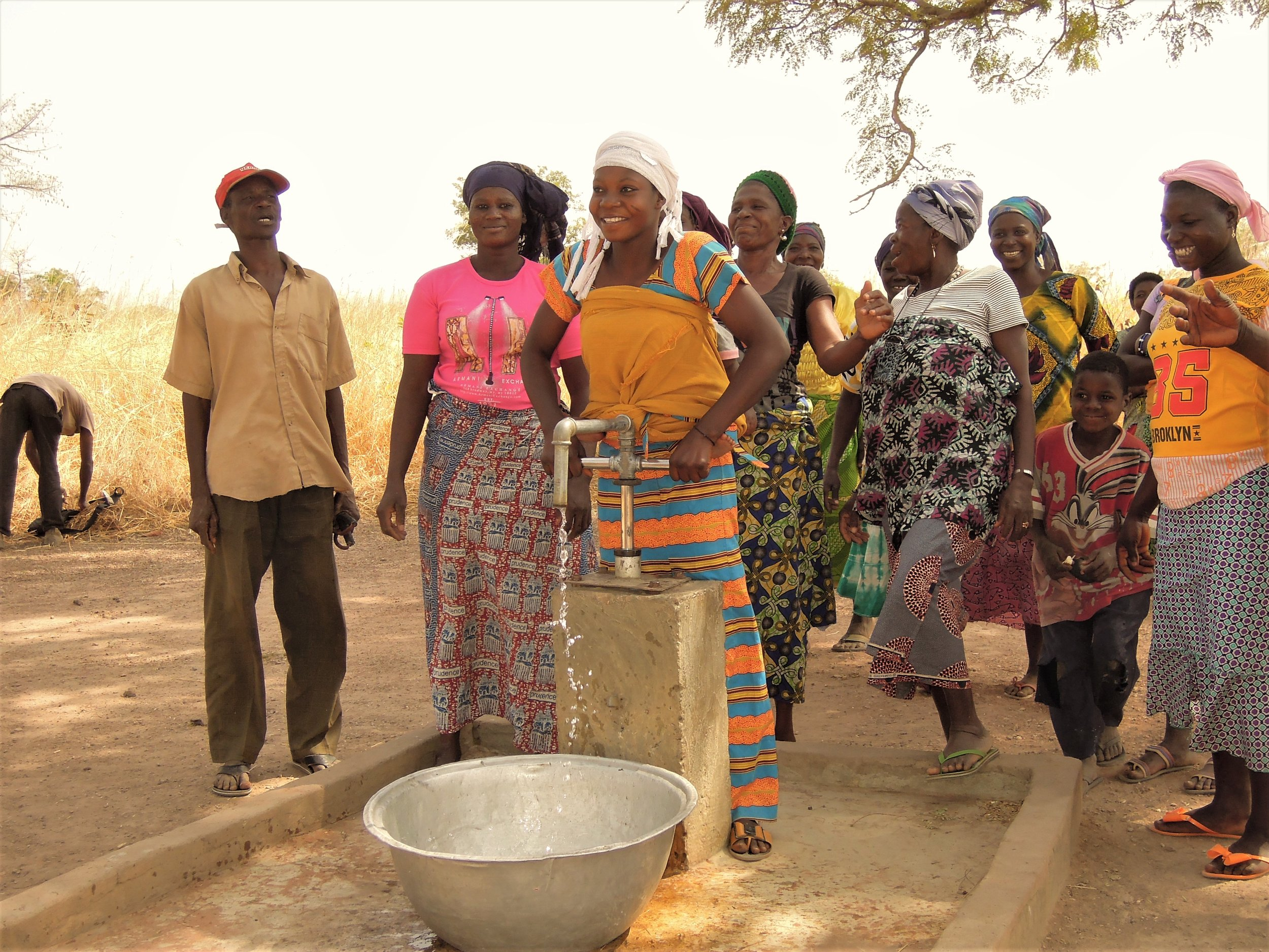 Women in Palabre 1 celebrate the new well.