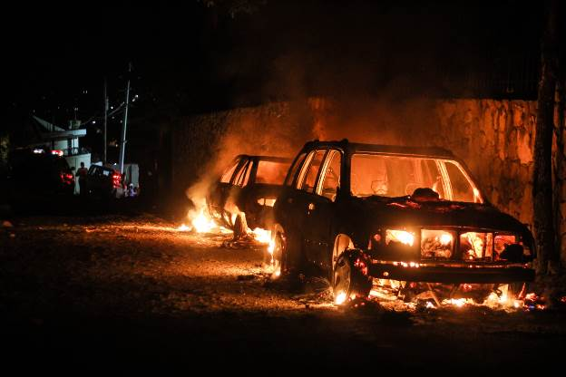 A guest's burning car, near the Red Cross building, August 10, 2013