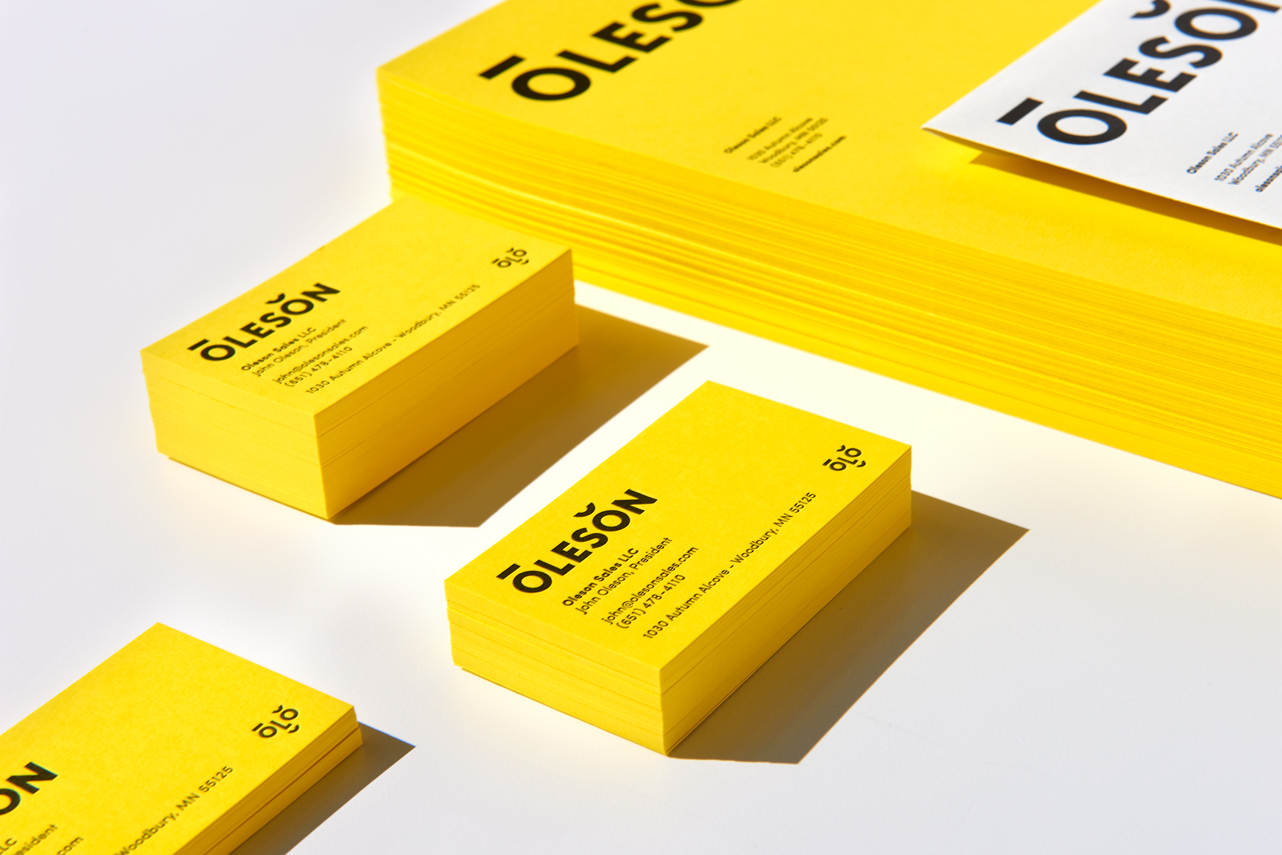 Oleson logo, business cards, and letterhead design. Designed by Abby Haddican at Werner Design Werks.