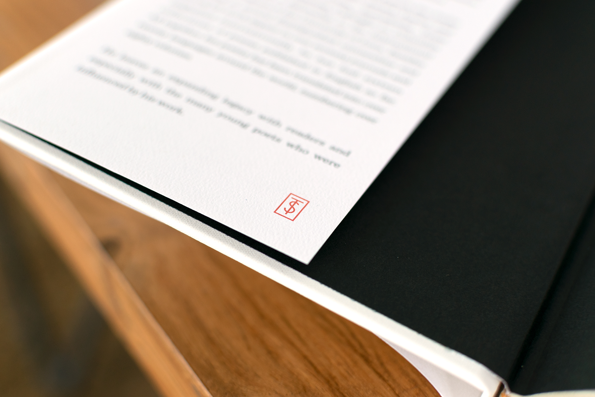Custom monogram for Tomaz Salamun book series designed by Abby Haddican.