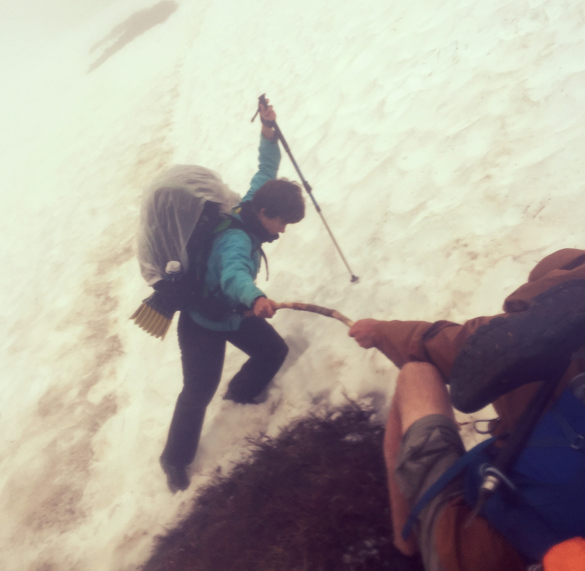 A SOBO hiker attempts to cross a steep section of snow between Red and White Pass