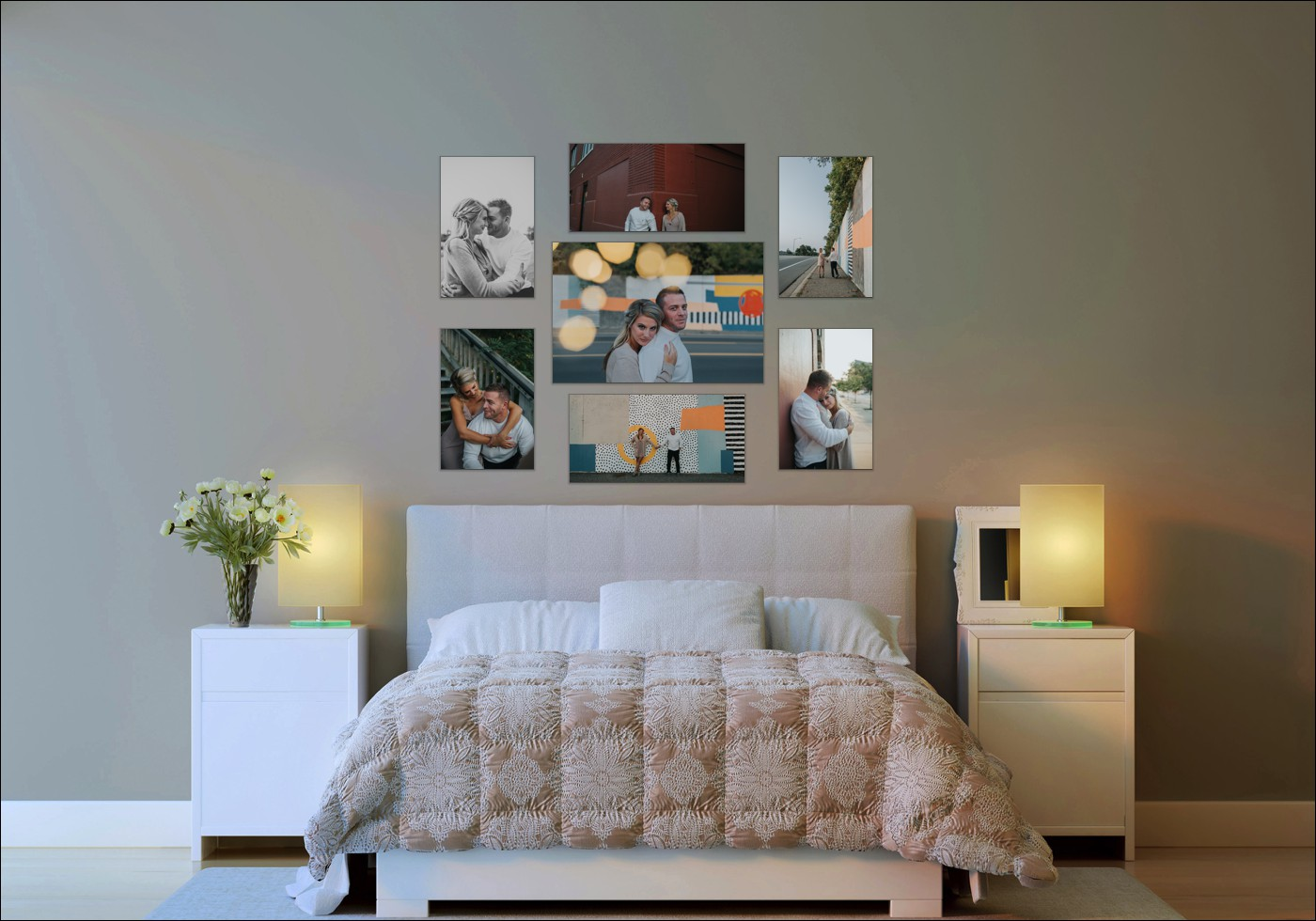 "Your artwork doesn't need to be limited to ""above the mantel"". Almost any wall space can be converted to be a showcase! A bedroom is perfect for engagement, couples sessions, or even a boudoir session! Shown here is a 36 x 24 inch canvas, with four 16 x 24 inch canvases on the sides, and two 30 x 15 inch canvases on the top and bottom. Different sizes draw the eye to different photos, and provide balance for your space."
