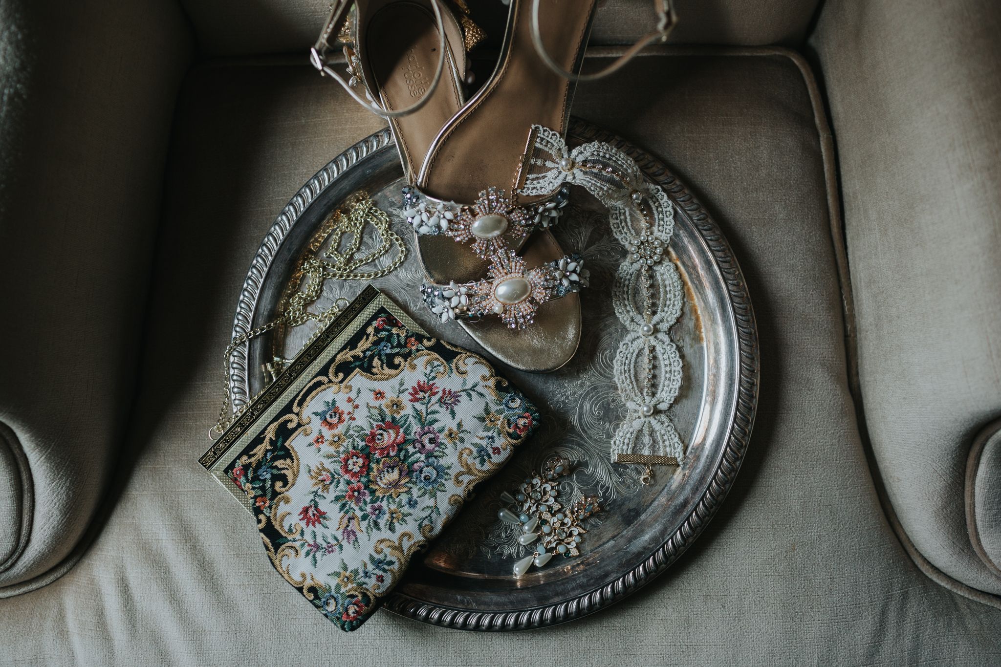 vintage wedding details on a silver tray.