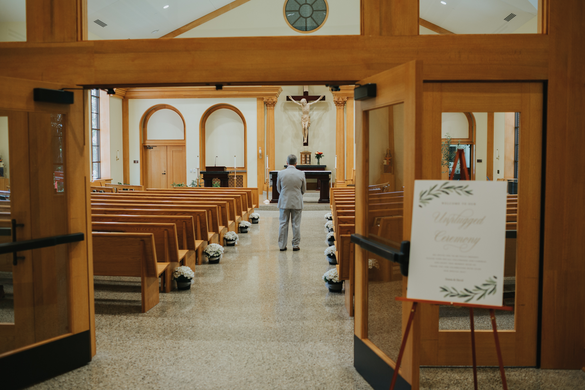 father waiting in church for first look