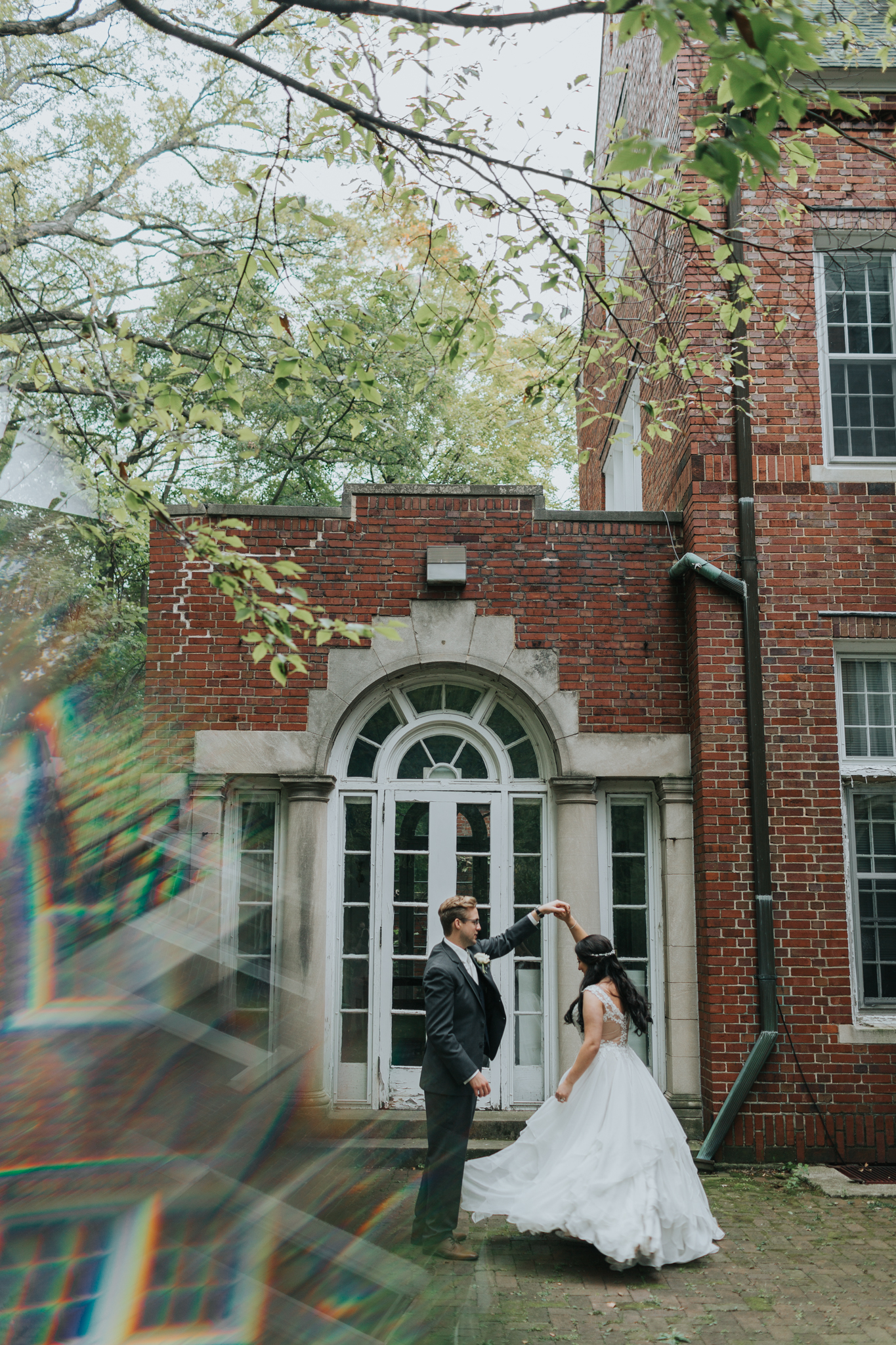 couple dancing in courtyard