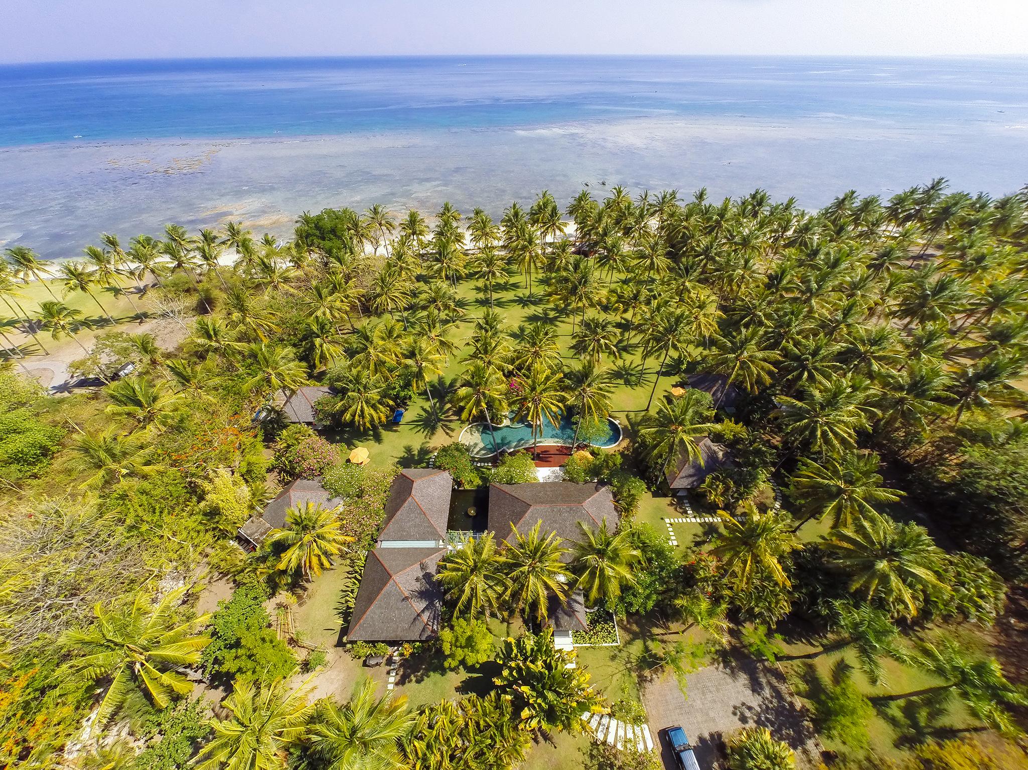 01-The Anandita - Villa grounds and ocean.jpg