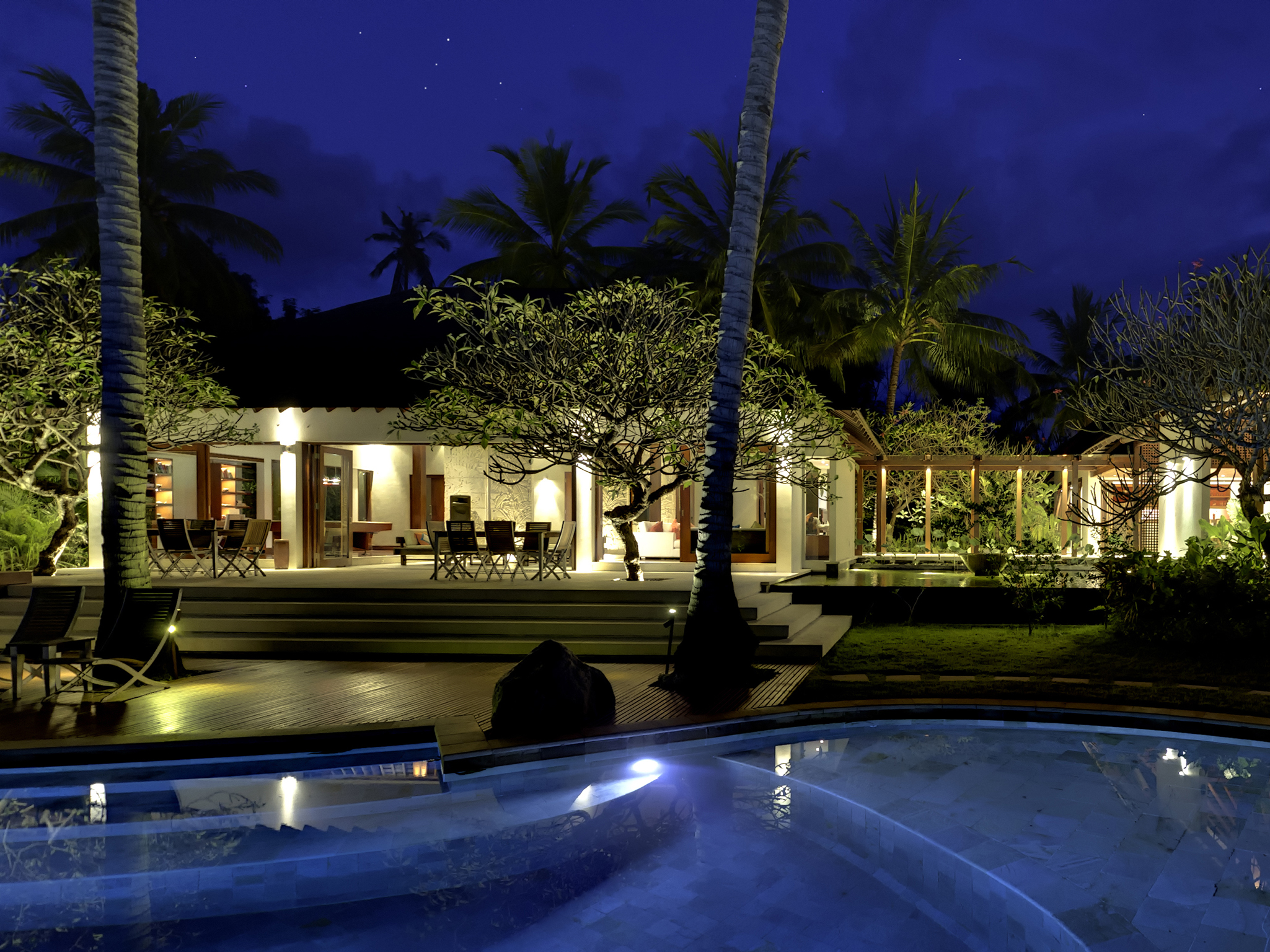 15-The Anandita - Pool and living room at night.jpg