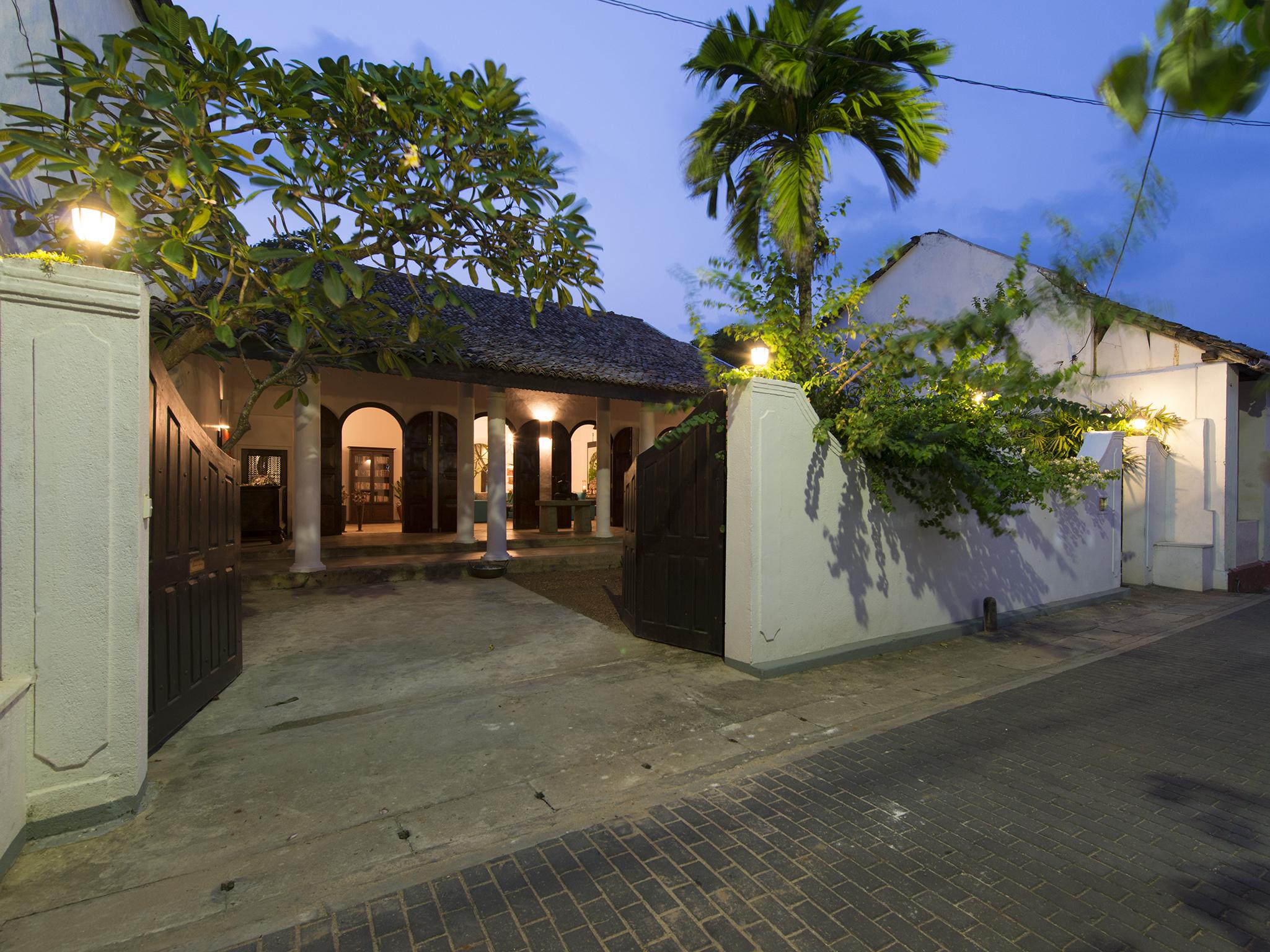 01-Ambassadors House - Entrance at night.jpg