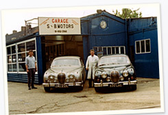 William and Peter with their prized Jags