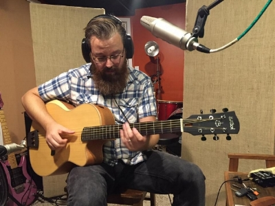 This is a snap shot of Lance in the studio using a Batson Guitar made with mahogany and spruce combination.