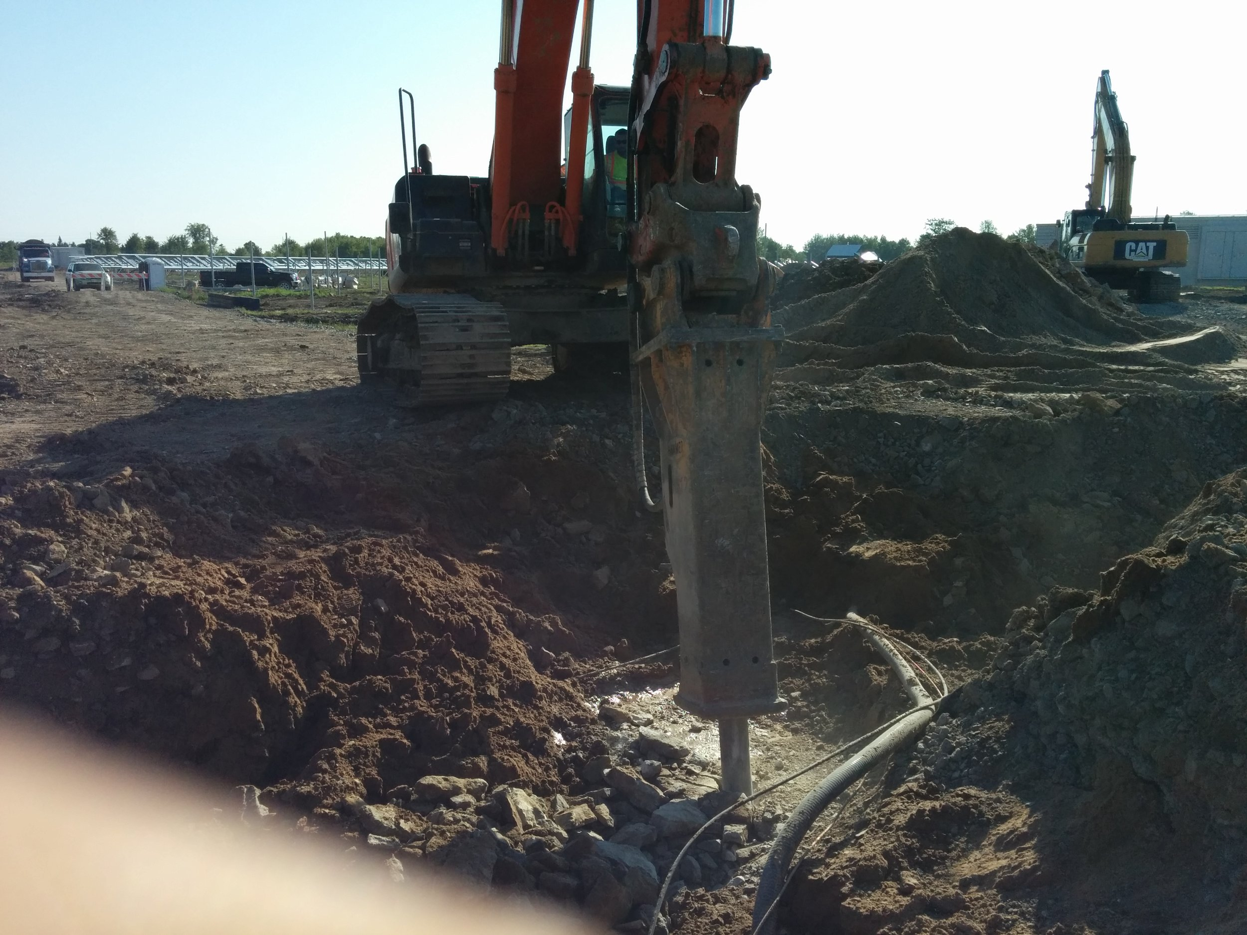 Installing trench under existing utilities.