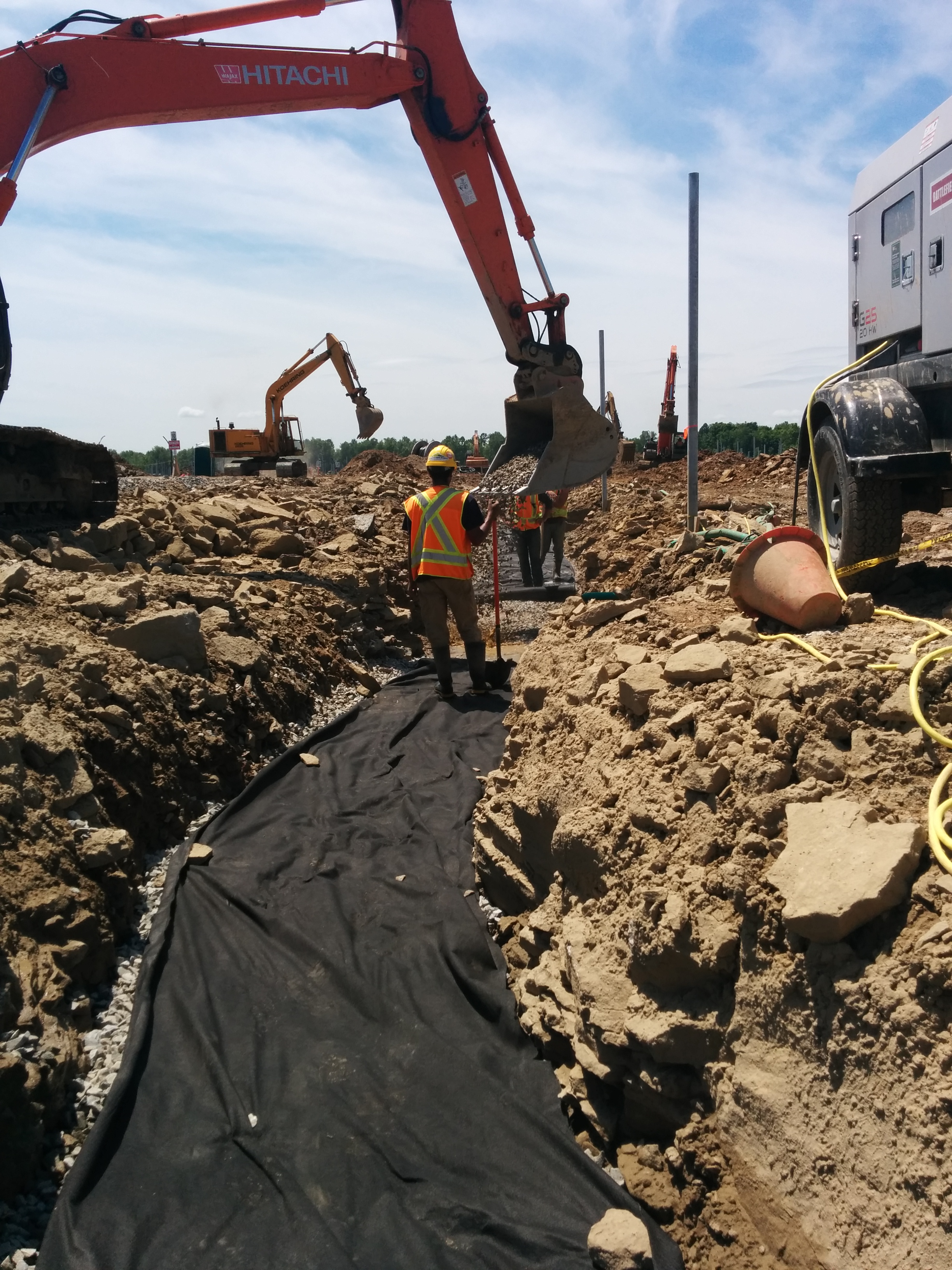 Installing water controls in DC cable trench.