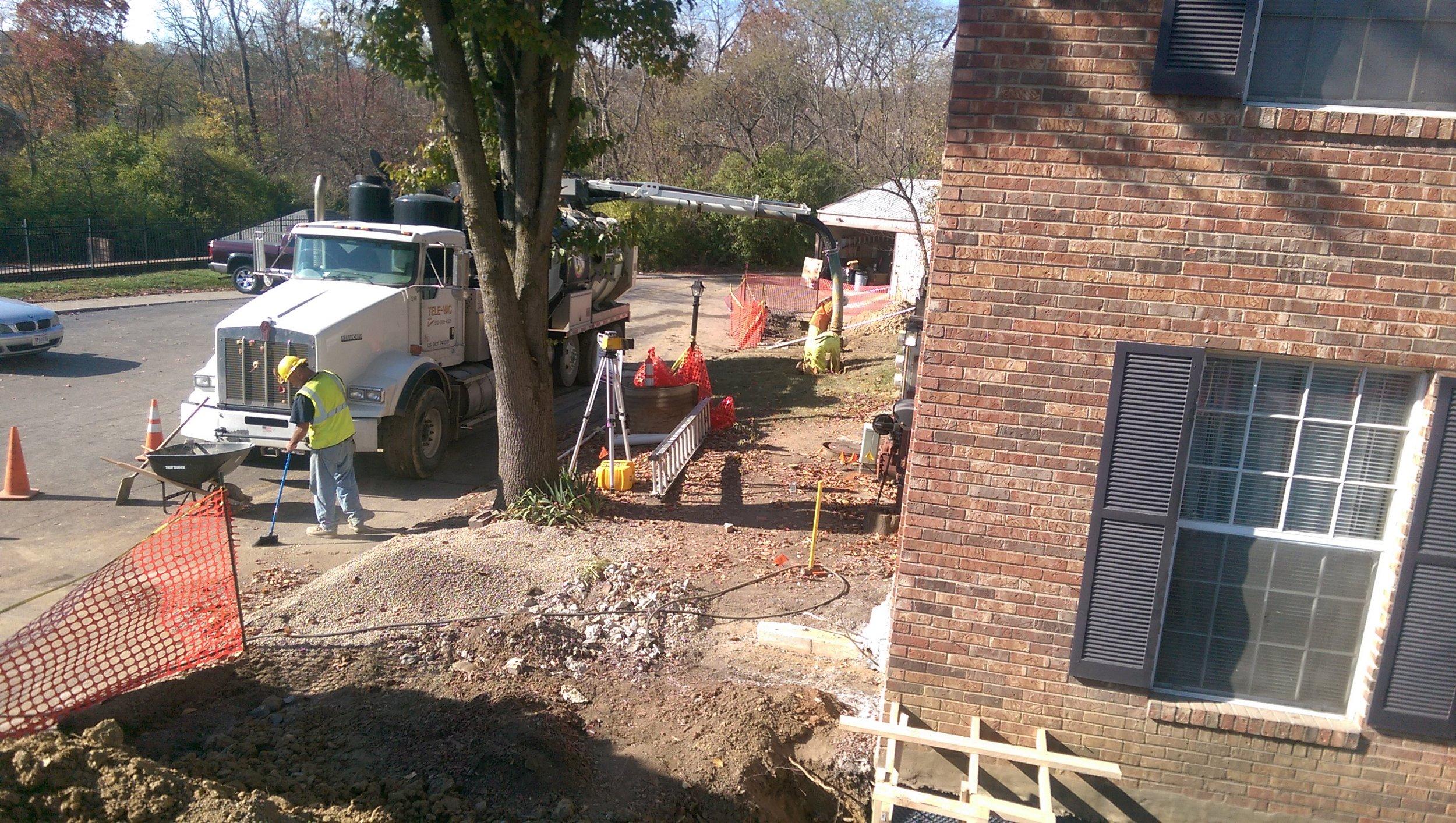 Hydro-excavating around existing utilities.