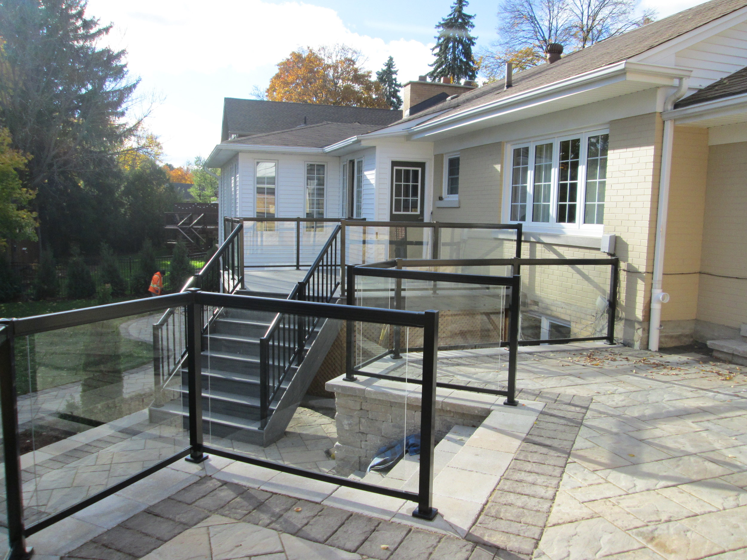 Custom steps, brick surface, and railings.