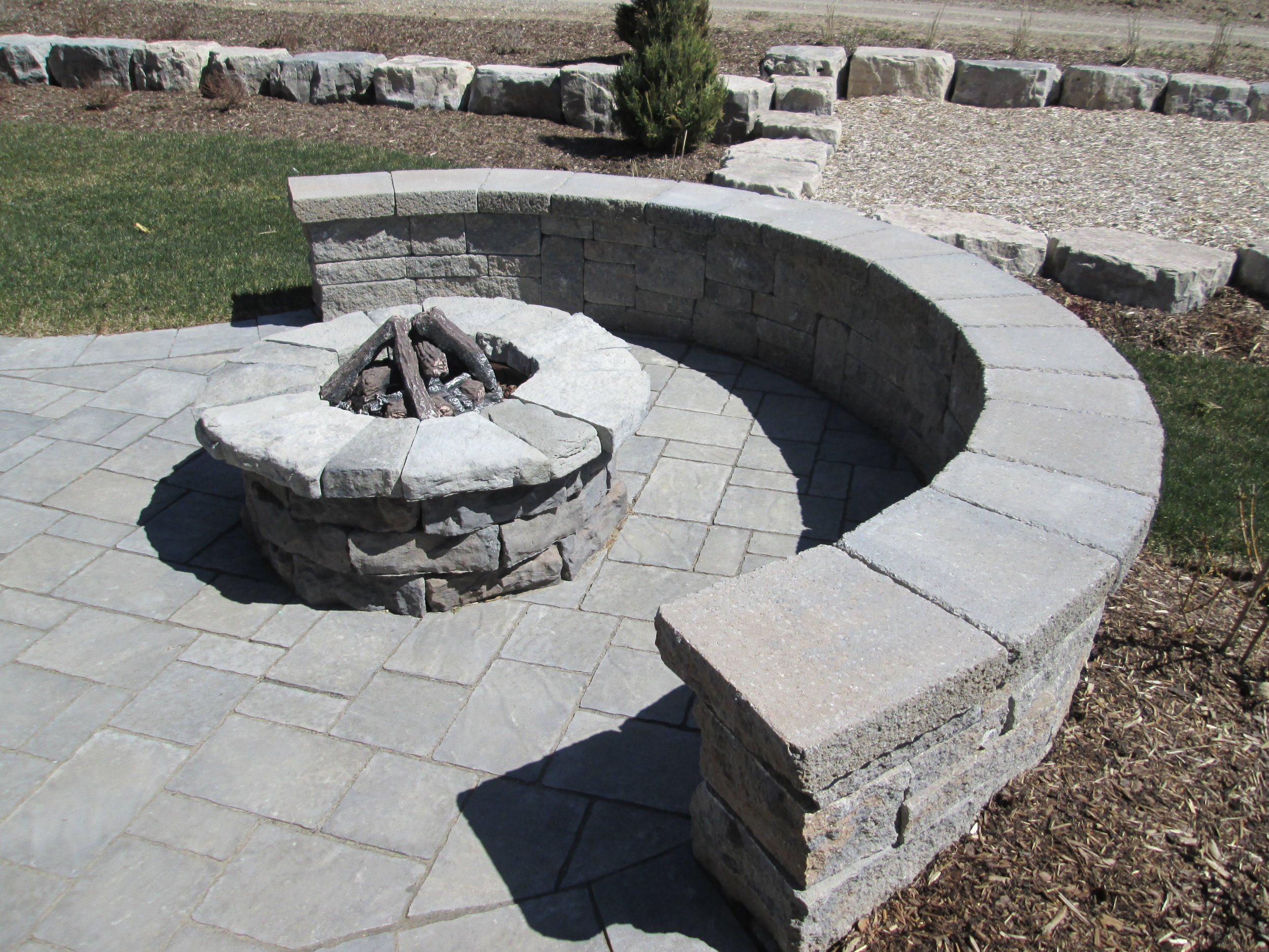 Custom fire-pit and seating area.