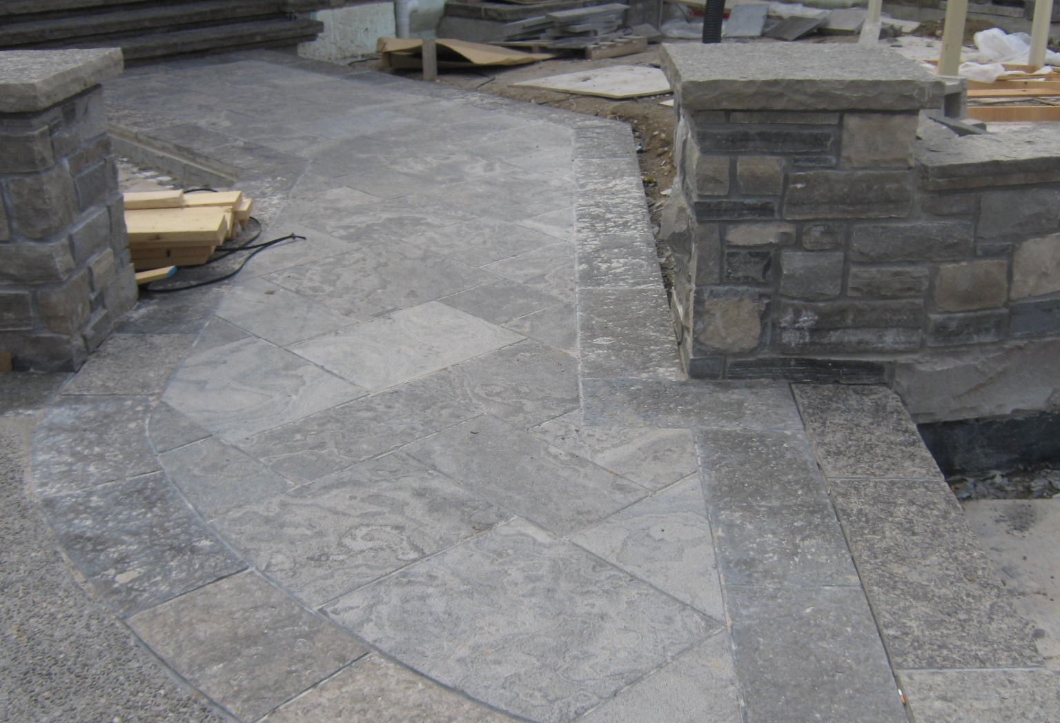 Custom stone layers, and exposed concrete meeting.