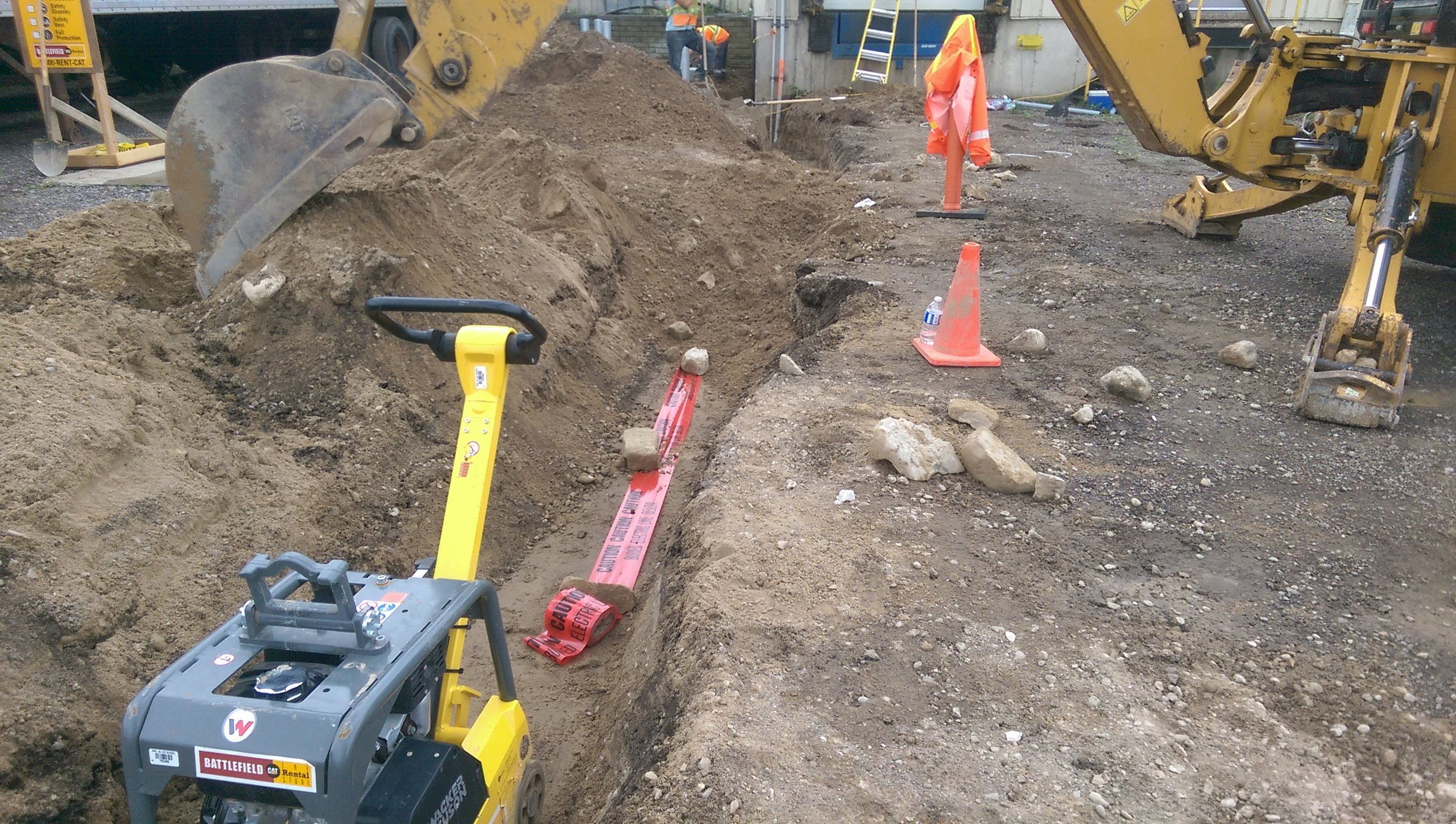Back-filling utility trench.