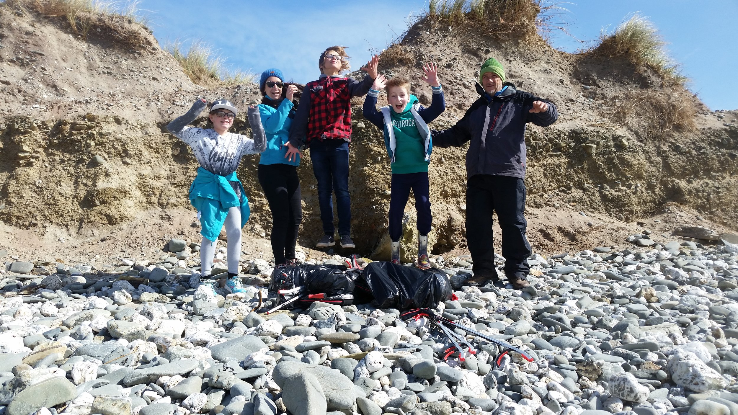 The whole beach cleaning gang with the day's haul ~400 pieces at 7kg, jumping for joy of finishing a hard clean