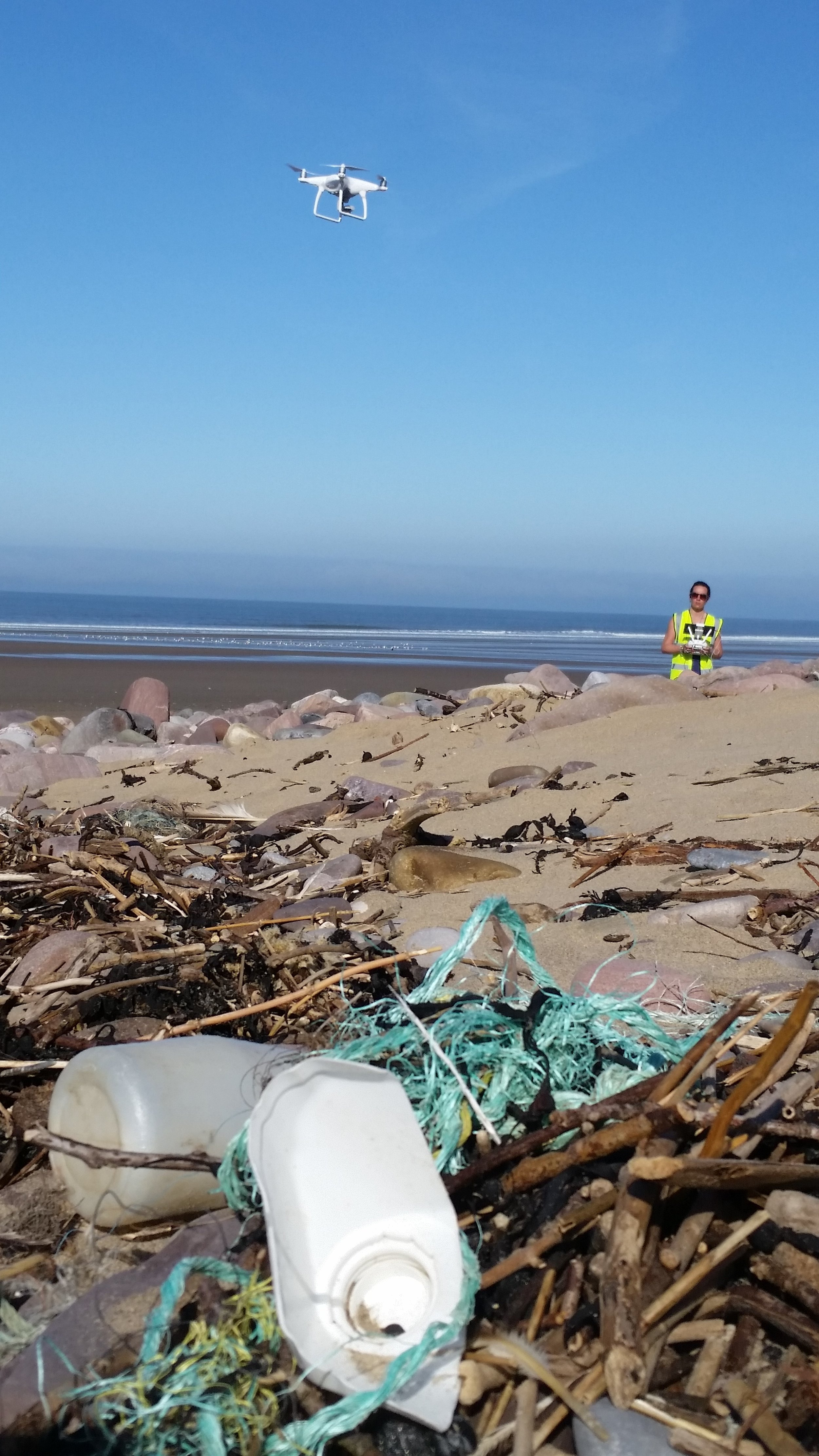 Ellie getting to work surveying the piles of litter on Rhossili beach